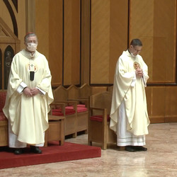 Cardinal Blase Cupich and Fr. Bill Vollmer observe social distancing standing six feet apart during Holy Thursday Mass on Thursday, April 9, 2020 at Holy Name Cathedral