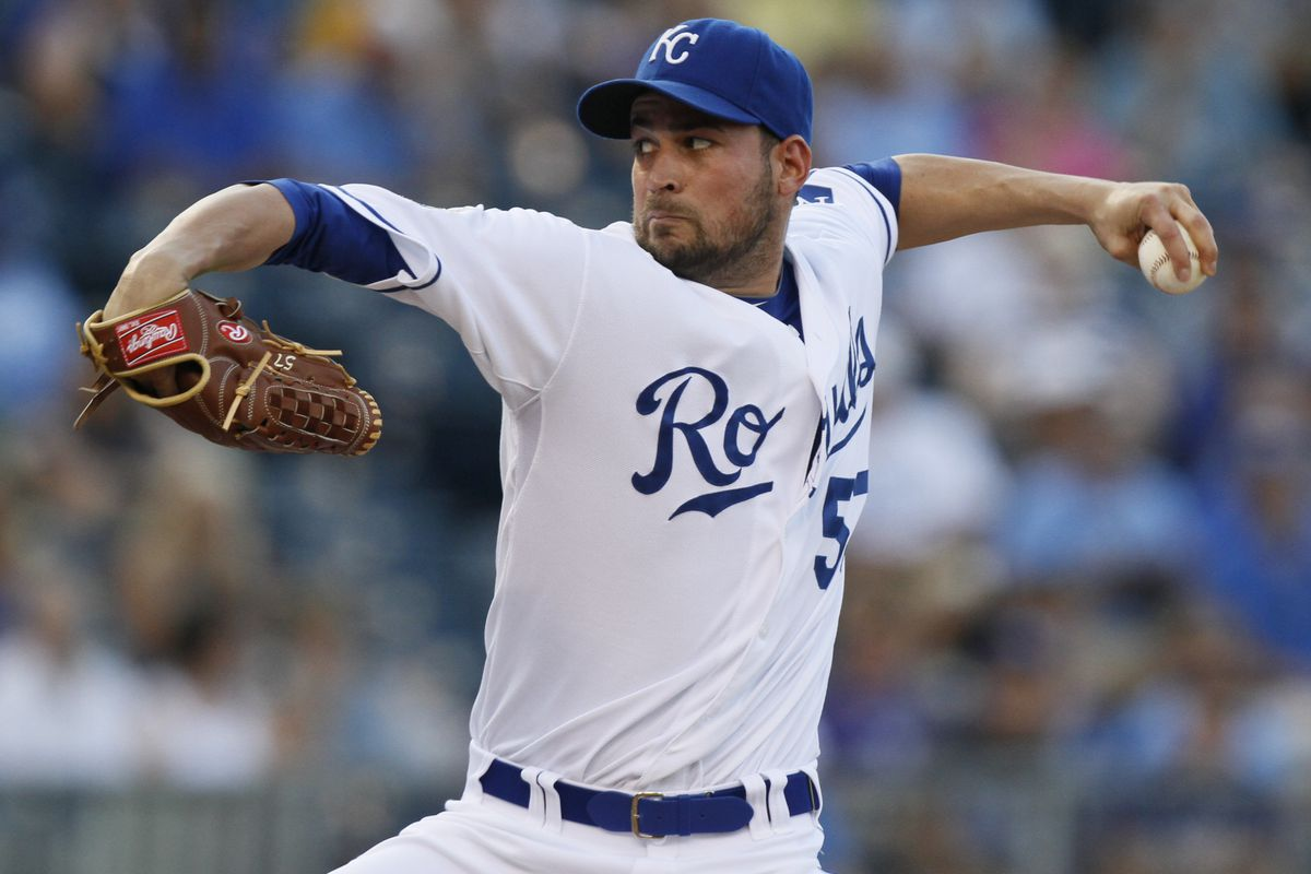 KANSAS CITY, MO - JULY 16: Jonathan Sanchez #57 of the Kansas City Royals pitches against the Seattle Mariners in the first inning at Kauffman Stadium on July 16, 2012 in Kansas City, Missouri. (Photo by Ed Zurga/Getty Images)