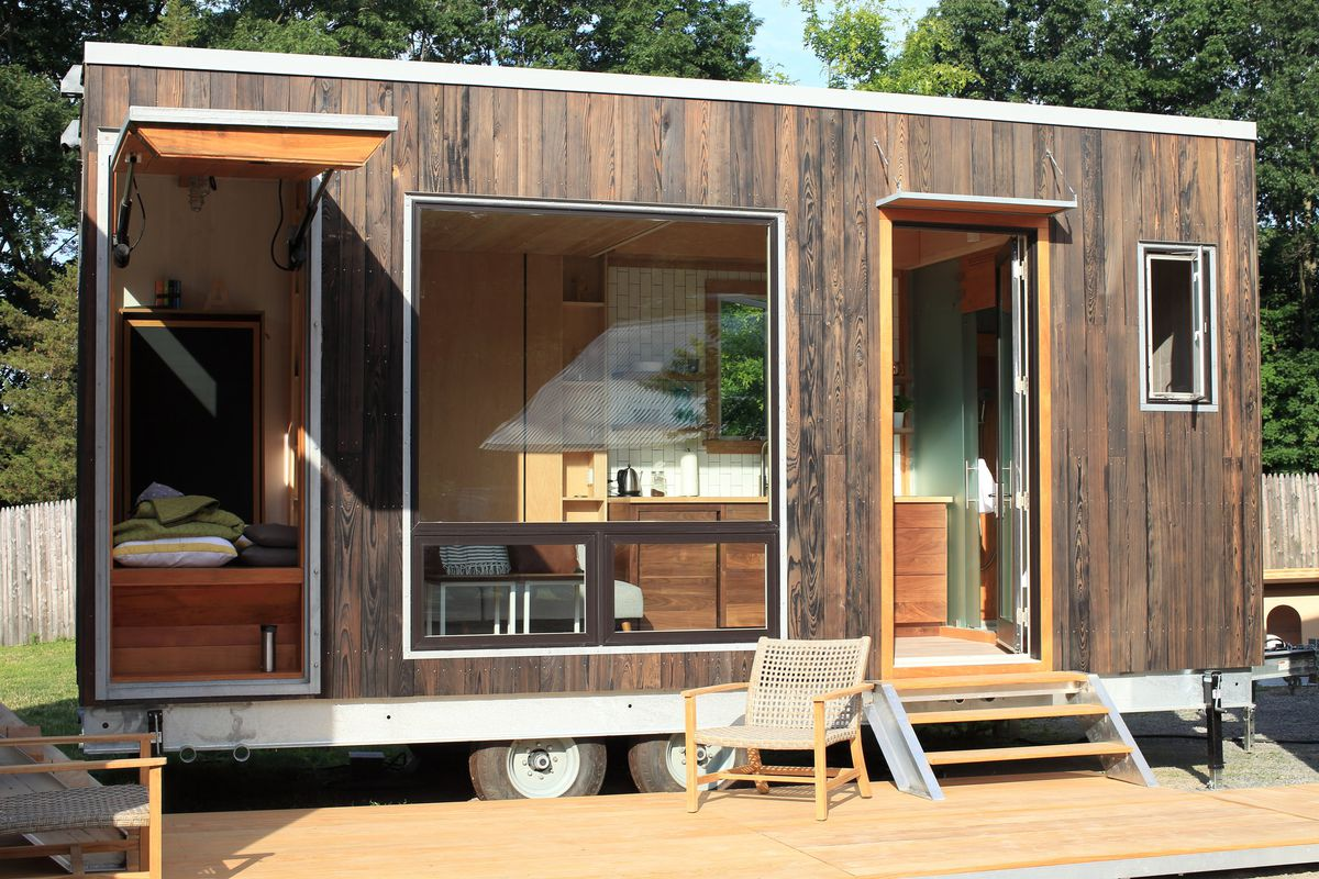 Modern tiny house hides a drop down bed curbed for Tiny house floor plans for sale