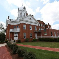 """This April 8, 2015, photo shows the old Monroe County Courthouse in Monroeville, Ala. The building, completed in 1903, is a centerpiece in the hometown of """"To Kill a Mockingbird"""" author Harper Lee, whose second book """"Go Set a Watchman"""" is set for release July 14, 2015."""