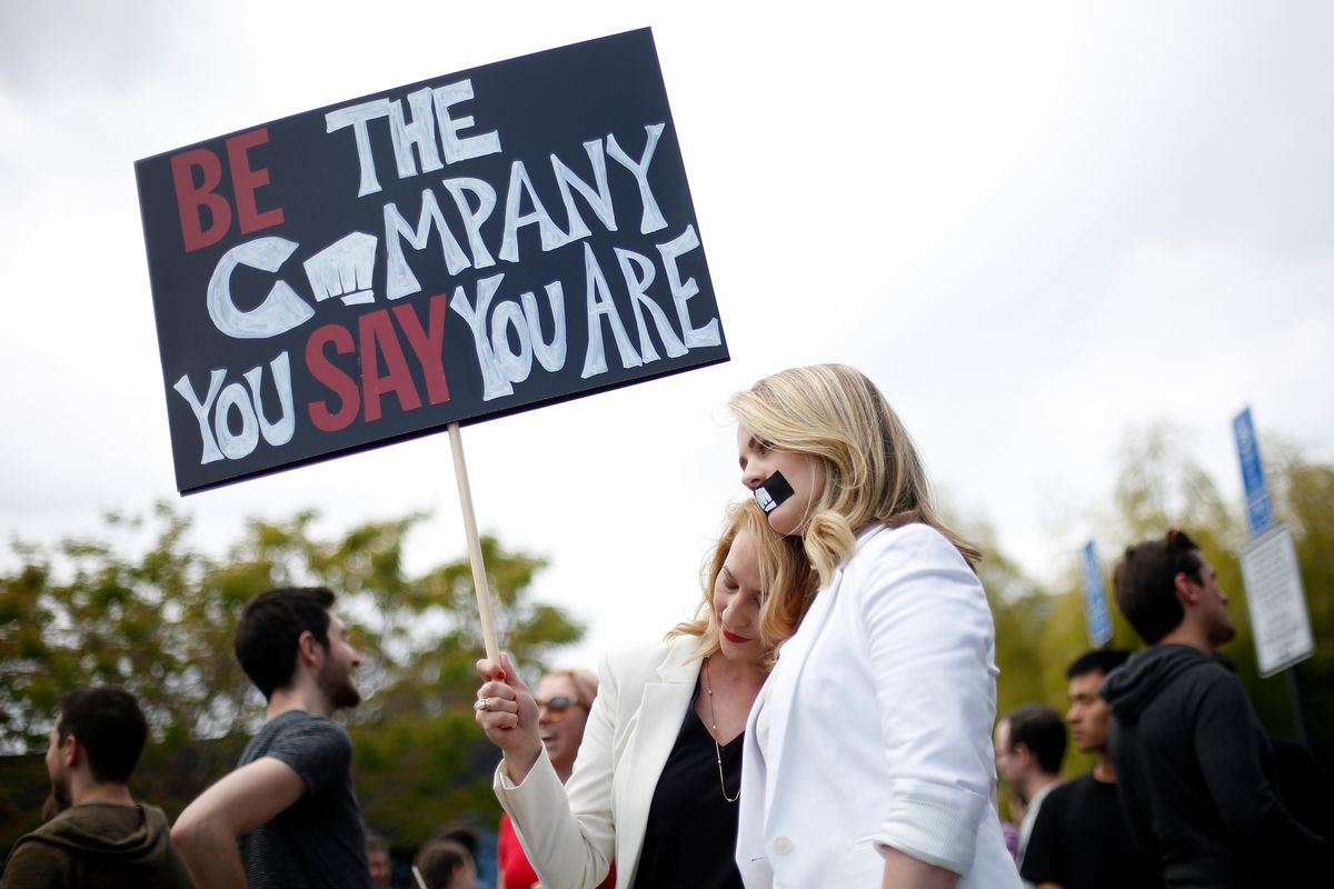 Chanel Dawnée, left, hugs Jess Kent, right, during a staged walk out at Riot Games to protest the company's move to force arbitration on sexual harassment lawsuits on May 6, 2019, in Los Angeles, California.