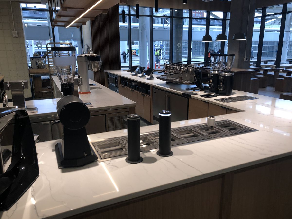 A photo of six stations for making pour-over coffee on the counter nside Kaffe Landskap