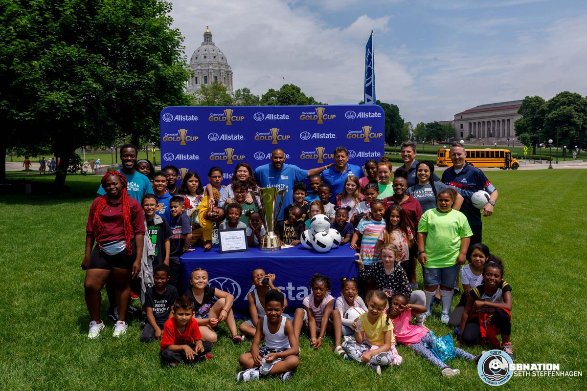 June 17, 2019 - Saint Paul, Minnesota, United States - Kids and staff from The Sanneh Foundation pose for a photo while at the Allstate Day For Play event on the lawn of the Minnesota State Capitol.