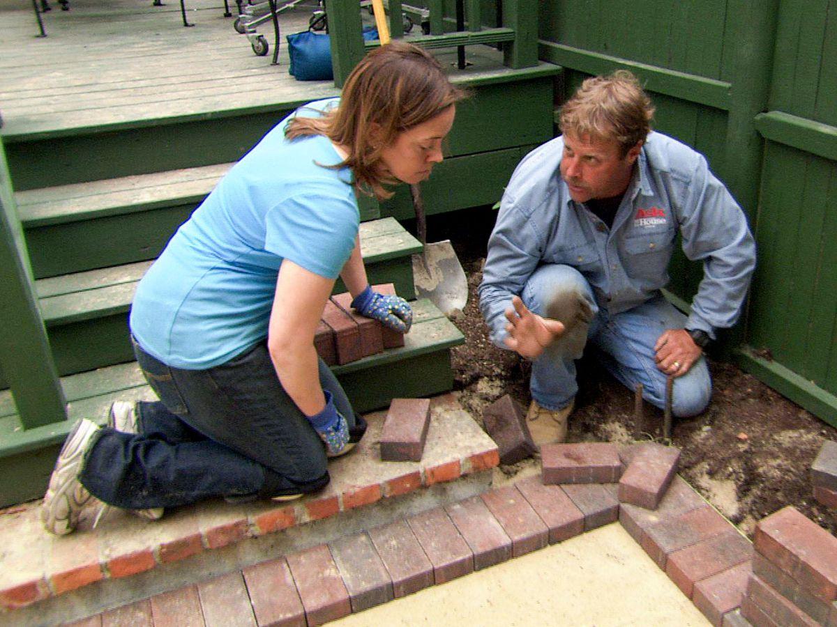 Roger Cook lays a brick perimeter