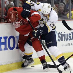 Detroit Red Wings center Valtteri Filppula (51), of Finland, and Nashville Predators defenseman Ryan Suter (20) battle for the puck during the first period of Game 3 of an NHL hockey Stanley Cup first-round playoff series in Detroit, Sunday, April 15, 2012.