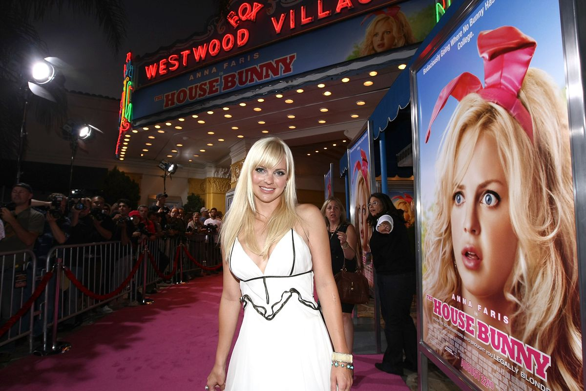 Anna Faris standing next to a poster for 'The House Bunny'