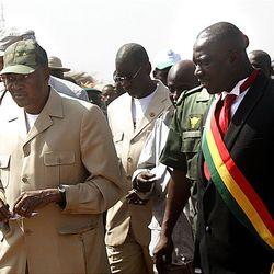 Current Malian president Amadou Toumani Toure, left, walks with candidate Yeah Samake.
