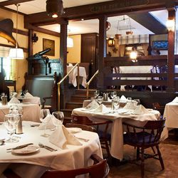Tucked away in the lower level of the Drake, the dark-wooded Cape Cod Room has been inviting people in with its New England nautical theme for nearly 80 years. The walls are dotted with copper pots, taxidermied sea life, ship figureheads and more. The ori