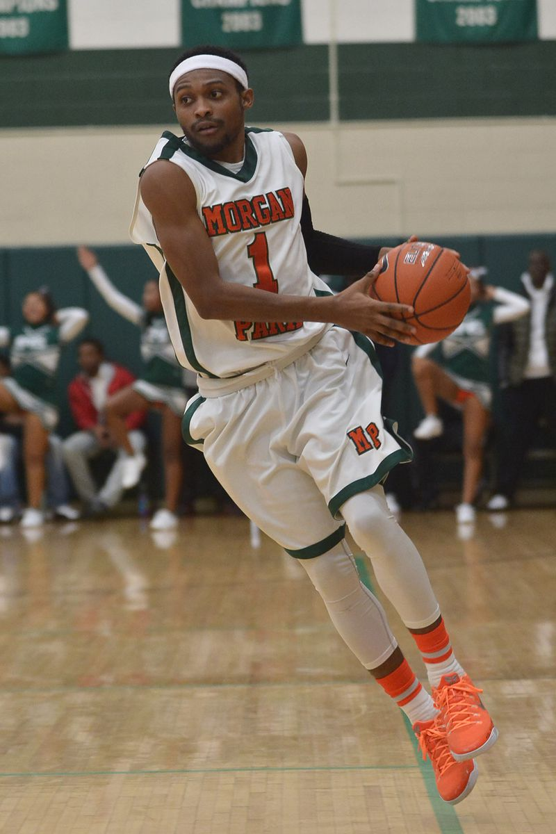 Morgan Park's Marcus Lovett (1) tries to find an open player.