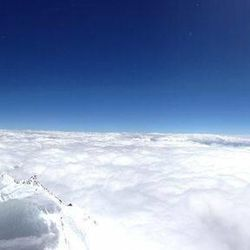 Mount Everest rises up above the clouds.