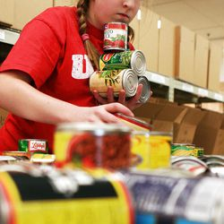 Caroline Crane, 14, volunteers with her family at the Utah Food Bank several times a year. At first, the kids groaned about the work, her mother, Patricia Crane, reported.