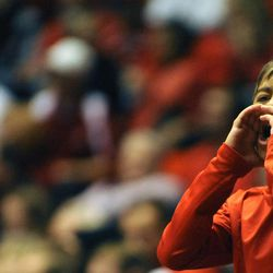A young Utes fan gives the ref grief during a game at the Jon M. Huntsman Center on Saturday, Dec. 14, 2013.