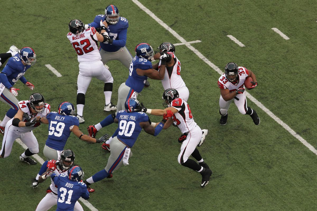 Michael Turner (33) of the Atlanta Falcons has no place to runon this play Sunday against a swarming New York Giants defense  (Photo by Nick Laham/Getty Images)