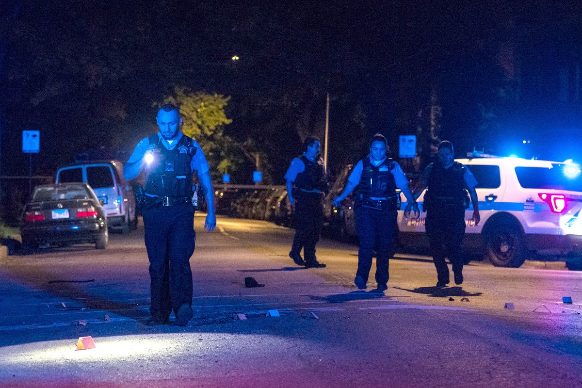 Chicago police investigate the scene where a man was shot dead, and another man was wounded, Aug. 31, 2019, in the 1500 block of North Spaulding, in the Humboldt Park neighborhood.