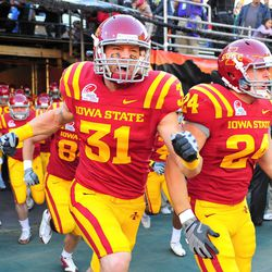 Iowa State Cyclones linebacker Justin Rumple (31) and wide receiver David Weber (24) run on to the field prior to the 2009 Insight Bowl against the Minnesota Golden Gophers at Sun Devil Stadium.