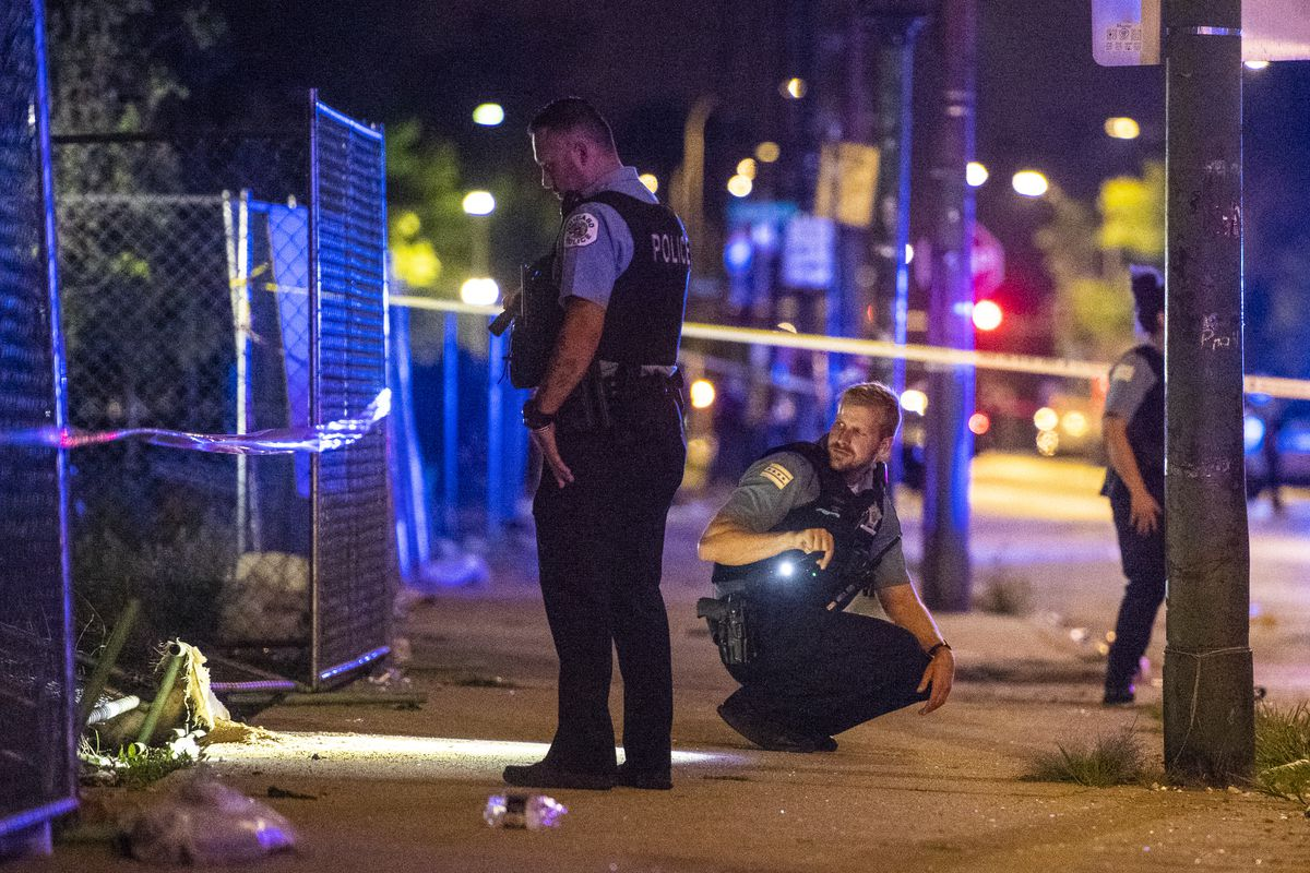 Police investigate the scene where multiple people were shot Sunday morning in the 1600 block of South Avers. | Tyler LaRiviere/Sun-Times
