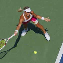 Czech Republic's Andrea Hlavackova returns a shot to Russia's Maria Kirilenko in the third round of play at the 2012 US Open tennis tournament,  Saturday, Sept. 1, 2012, in New York.