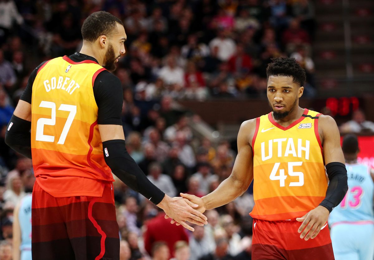 Utah Jazz center Rudy Gobert (27) and Utah Jazz guard Donovan Mitchell (45) five each other as the Utah Jazz and the Miami Heat play in an NBA basketball game at Vivint Smart Home Arena in Salt Lake City on Wednesday, Feb. 12, 2020. Utah won 116-101.