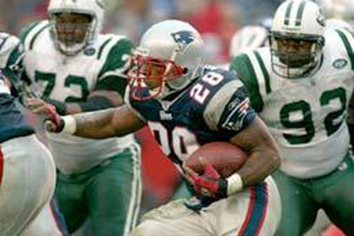New England running back Corey Dillon tries to elude a bunch of New York Jets defenders.