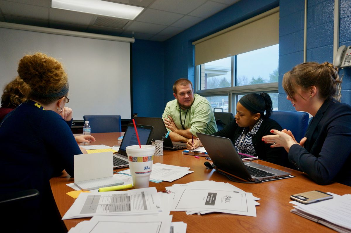 The multi-classroom leaders meet regularly with teachers and district coaches to review data and plan lessons.