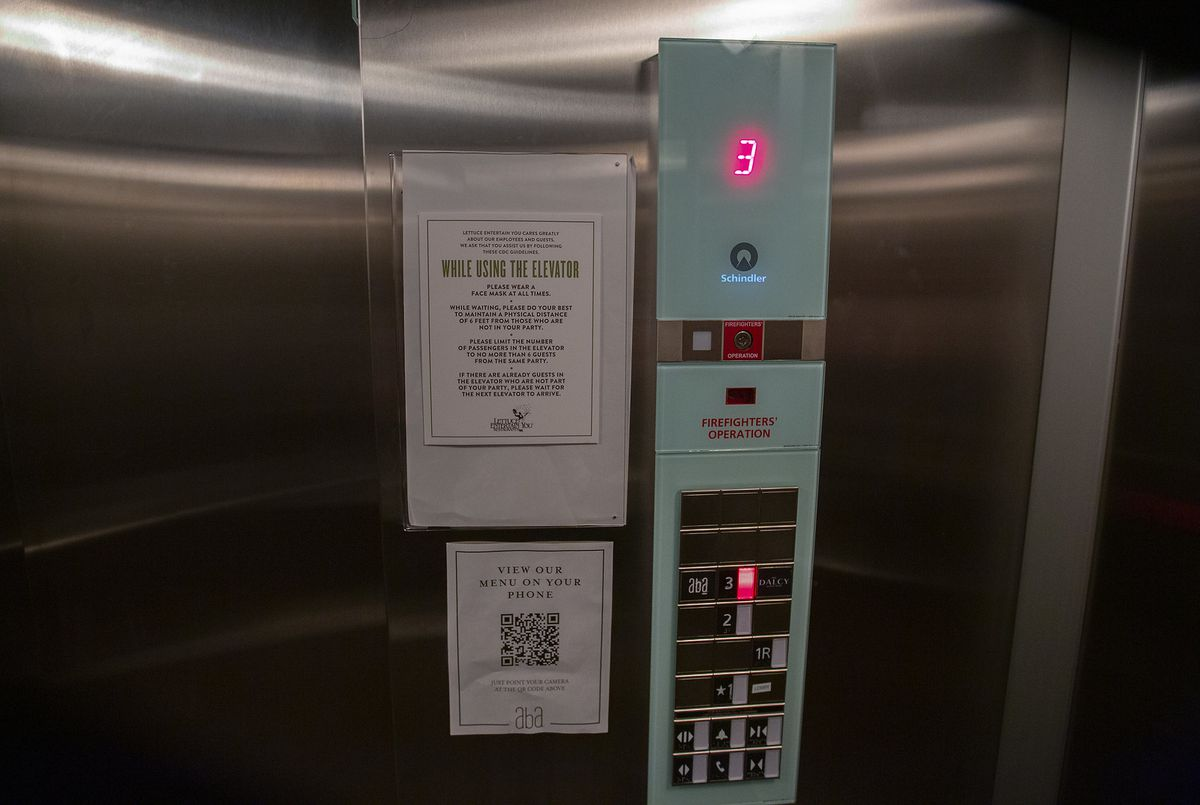 The steel wall of an elevator.