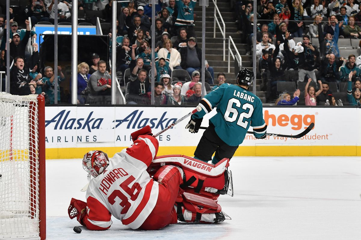 SAN JOSE, CA - NOVEMBER 16: Kevin Labanc #62 of the San Jose Sharks scores against Jimmy Howard #35 of the Detroit Red Wings at SAP Center on November 16, 2019 in San Jose, California.