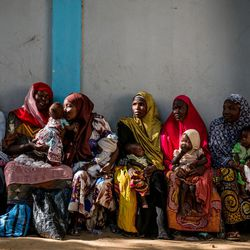 Women wait with their children at the Dalaram health and malnutrition clinic run by the government and supported by UNICEF in Old Maiduguri, Borno State, Nigeria, on March 2, 2017.