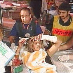 Emergency crew in Eilat, Israel, assist a victim of a blast on Egypt's Sinai Peninsula.