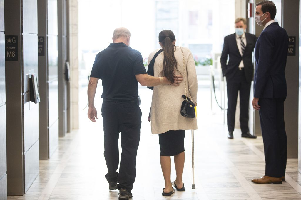 Michael Ryan, left, and Shannon Ryan, right, leave the press conference after announcing a lawsuit after a hit and run left Zoraleigh Ryan, 55, dead, at 161 N Clark St in the Loop, Wednesday, Aug. 26, 2020.