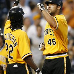 Pittsburgh Pirates' Garrett Jones, right, is greeted at home plate by teammate Andrew McCutchen after hitting a three-run homer against the Cincinnati Reds.