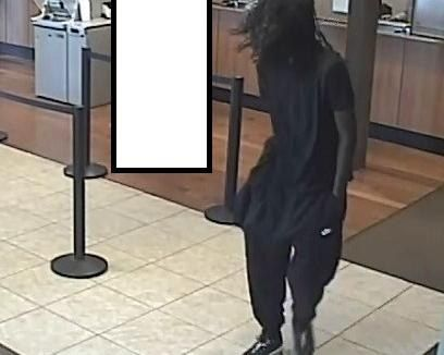 Surveillance video shows a suspect in an Aug. 19, 2019 bank robbery at a Chase Bank at 11721 S. Halsted St. in Chicago.   FBI