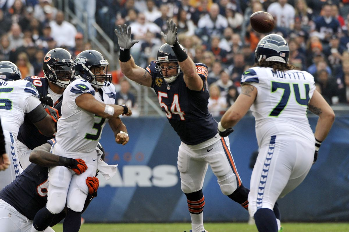 HOF finalist Brian Urlacher  54 of the Chicago Bears tries to block a pass  by Russell Wilson  3 of the Seattle Seahawks on December 2 cc140cb05