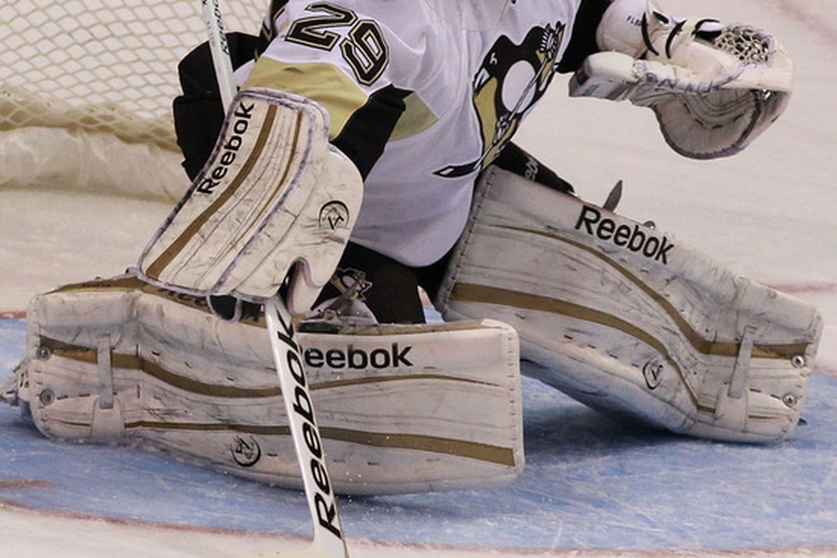 DALLAS, TX - FEBRUARY 29:  Marc-Andre Fleury #29 of the Pittsburgh Penguins plays the puck against the Dallas Stars at American Airlines Center on February 29, 2012 in Dallas, Texas.  (Photo by Ronald Martinez/Getty Images)