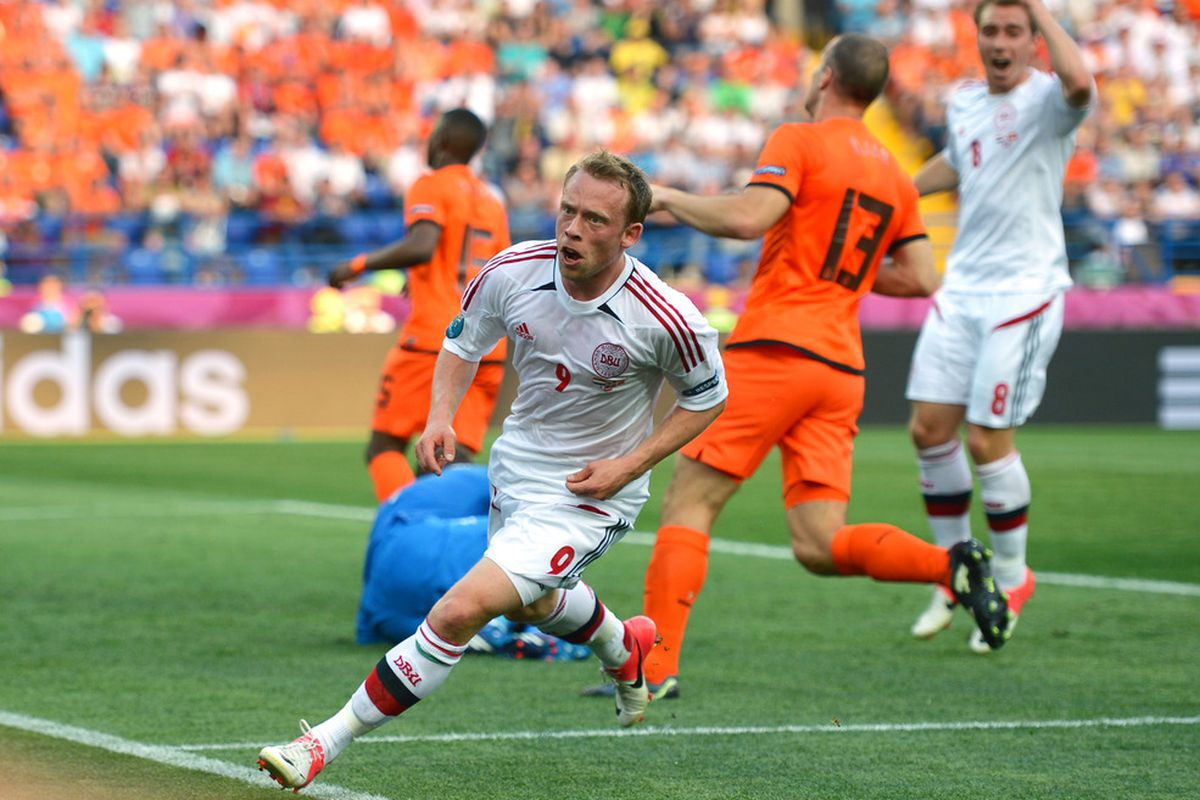 Michael Krohn-Dehli of Denmark turns to celebrate scoring their first goal during the game against Holland.