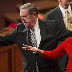 Elder Jeffrey R. Holland and his wife Patricia wave as they leave the stand following the Sunday afternoon session of the 183rd Semiannual General Conference for the Church of Jesus Christ of Latter-day Saints Sunday, Oct. 6, 2013 inside the Conference Center.