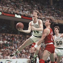 Danny Ainge (44) of the Boston Celtics reacts as he goes past Houston Rockets Jim Petersen in first half NBA playoff action at Boston Garden, Monday, May 26, 1986, Boston, Mass.