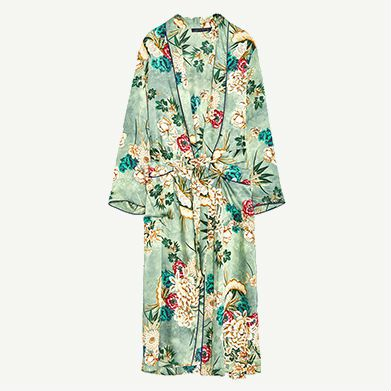 Green silk coat with floral detailing.