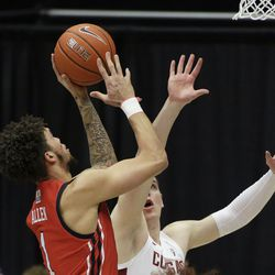 Utah forward Timmy Allen, left, shoots over Washington State forward Andrej Jakimovski during the first half of an NCAA college basketball game in Pullman, Wash., Thursday, Jan. 21, 2021.