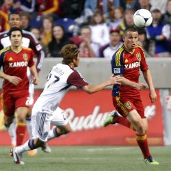 Luis Gil of Real Salt Lake battles for control of the ball against Kosuke Kimura of the Colorado Rapids during their MLS match up at Rio Tinto Stadium in Sandy Saturday, April 7, 2012.