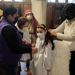 The family of Ivana Paramo helps her get ready for Via Crucis at Providence of God Church in Pilsen, Friday morning, April 2, 2021. The annual Via Crucis is a Good Friday tradition that reenacts the Stations of the Cross, a Catholic devotion that recounts Jesus' passion and death.