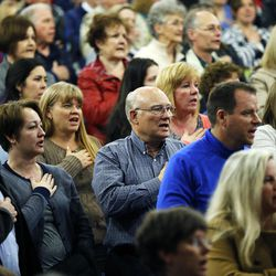 Those in attendance pledge allegiance during a Utah Republican caucus at Brighton High School in Salt Lake City on Tuesday, March 22, 2016.