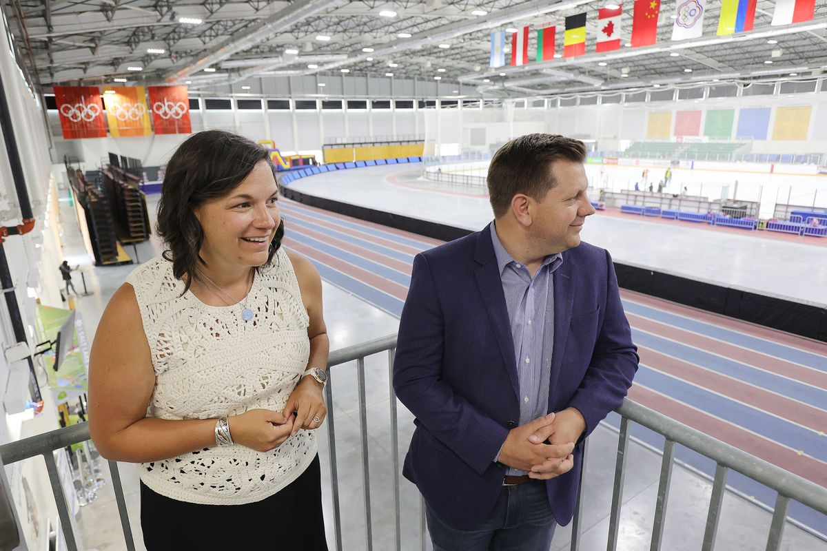 Catherine Raney Norman,chairwoman of the Salt Lake City-Utah Committee of the Games, andSteve Starks, committee vice chairman andOlympic adviser to Gov. Spencer Cox, look over the Utah Olympic Oval in Kearns.
