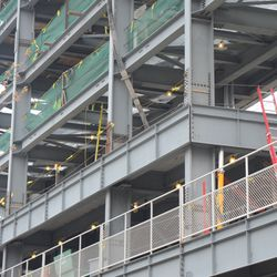 1:25 p.m. Closer view of the concrete being poured on the upper level -