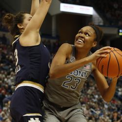 UConn's Azura Stevens (23) looks to get up a shot over Notre Dame's Kathryn Westbeld (33) during the Notre Dame Fighting Irish vs UConn Huskies women's college basketball game in the Women's Jimmy V Classic at the XL Center in Hartford, CT on December 3, 2017.