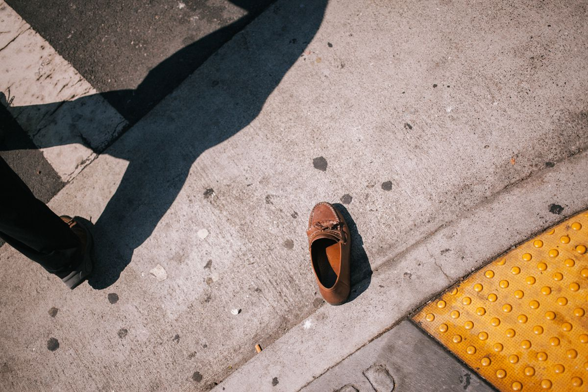 An abandoned shoe on the streets of San Francisco, subdued tones