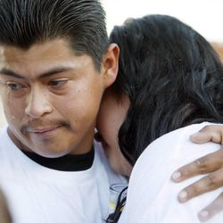 Ricardo Portillo's daughter Johana Portillo-Lopez is comforted by Juan Munoz as she talks about her father during a press conference Sunday, May 5, 2013 at the Portillo home. Portillo died Saturday May 4 from injuries sustained from being hit by a 17-year-old soccer player. Funeral services will be Wednesday.