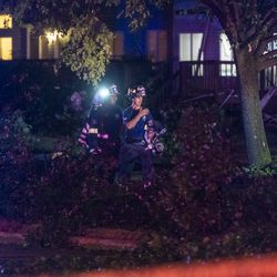 Firefighters navigate around fallen trees and branches that litter Cobblebrook Ln near Ranchview Dr, after a tornado touched down near suburban Woodridge, Monday, June 21, 2021.