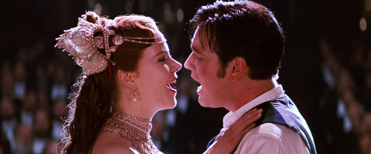 Nicole Kidman in an elaborate headdress and Ewan McGregor looking all scuffed-up stand onstage and sing real hard directly into each other's mouths in the climax of Moulin Rouge