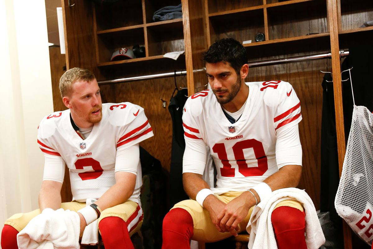 C.J. Beathard #3 and Jimmy Garoppolo #10 of the San Francisco 49ers sit in the locker room prior to the game against the Kansas City Chiefs at Arrowhead Stadium on September 23, 2018 in Kansas City, Missouri.