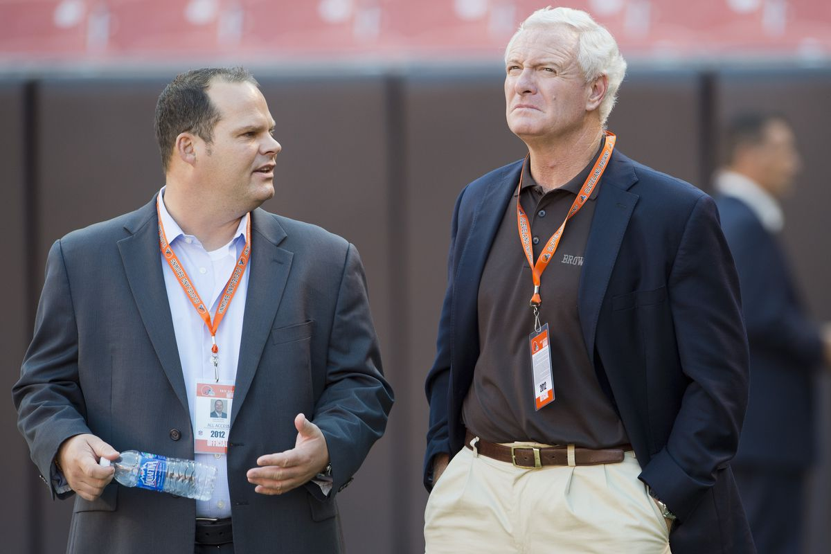Cleveland Browns General Manager Tom Heckert (L) and new team owner Jimmy Haslam talk on the field prior to the preseason game between the Cleveland Browns and the Chicago Bears at Cleveland Browns Stadium on August 30, 2012 in Cleveland, Ohio.